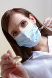 Female dentist with tools Royalty Free Stock Photo