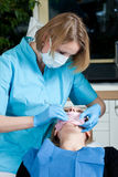 Female dentist working royalty free stock photo