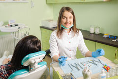 Female dentist working at dental clinic with female patien Royalty Free Stock Images