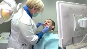 Female dentist working. stock video