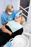 Female dentist works with patient at office Stock Photography