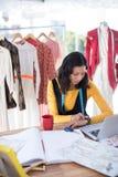 Female designer adjusting smart watch Stock Image