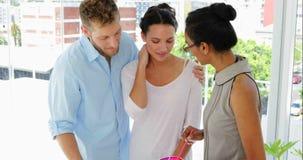 Female designer advising young couple