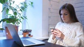 Female Designer Browsing Online on Smartphone, Web. 4k , high quality stock video