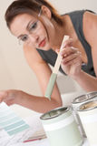 Female designer with can of paint Stock Photos