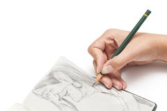 Female designer drawing a character Stock Photography