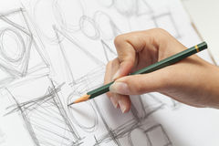Female designer drawing. Close-up photograph of a designer making sketch Royalty Free Stock Photography