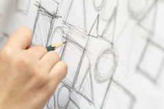 Female designer drawing. Close-up photograph of a designer making sketch Royalty Free Stock Photos