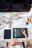 Female designer drawing on graphic table Stock Photos