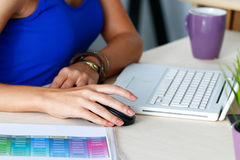 Female designer hands working with laptop computer Stock Images
