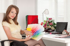 Female designer of interior. Royalty Free Stock Photo