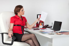 Female designer of interior. Young female designer of interior sits on the workplace at the office stock image