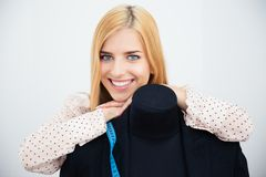 Female designer leaning on the mannequin Royalty Free Stock Images