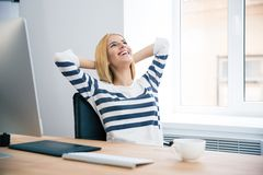 Female designer resting in office Stock Photography