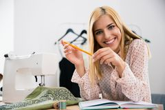 Female designer sitting at her workplace in workshop a Royalty Free Stock Photography