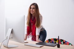 Female designer standing at her workplace Royalty Free Stock Image