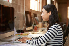 Female Designer Using Computer At Desk In Modern Office Stock Photography