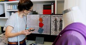 Female designer using mobile phone 4k. Female designer using mobile phone at home 4k stock video