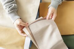 Free Female Designer With Fabric Color Samples Choosing Textile For Curtains Royalty Free Stock Photo - 217600485