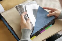Free Female Designer With Fabric Color Samples Choosing Textile For Curtains Stock Image - 217600491