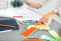 Female designer working with color palette sample. S at table royalty free illustration