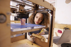 Female Designer Working With 3D Printer In Design Studio stock images
