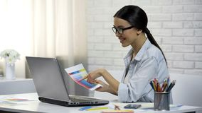 Female designer working remotely at home, coordinating color palette with client. Stock photo royalty free stock photo