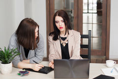 Female designers discussing corporate style royalty free stock images