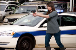 Female Detective. A beautiful police detective woman on the job with a gun royalty free stock image
