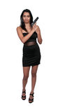 Female Detective. Beautiful police detective woman on the job with a gun royalty free stock images