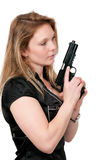 Female Detective. Beautiful police detective woman on the job with a gun stock photography