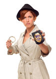 Female Detective With Handcuffs and Badge. Red Haired Female Detective With Handcuffs and Badge In Trenchcoat Isolated on a White Background Royalty Free Stock Images
