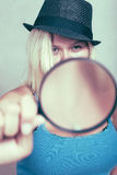 Female detective with magnifying glass Stock Photography