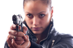 Female detective shooting with gun. Isolated on white background Stock Photography