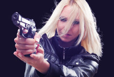 Female detective shooting with gun on street at night Stock Images