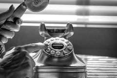 Female dials phone Stock Photo