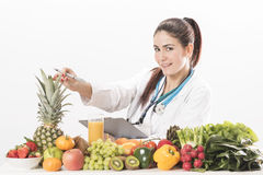 Female dietitian. On white background Royalty Free Stock Photos
