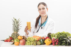 Female dietitian. On white background Royalty Free Stock Photography