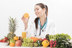 Female dietitian. On white background Royalty Free Stock Photo