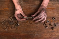 Female dirty hands screw nut bolt modern job Royalty Free Stock Images