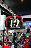 Female disc jockey in chengdu auto show. Female disc jockey at the scene of the chengdu auto show, play music on the car Royalty Free Stock Photo