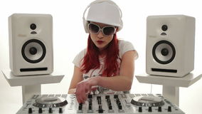 Female Disc Jockey Mixing Music between Stereos stock video footage