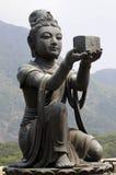 Female disciple statue at Big Buddha, Hong Kong. Female disciple statue offering a gift to the Big Buddha at Po Lin monastery, Lantau Island, Hong Kong Royalty Free Stock Photo