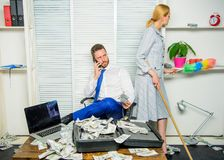 Female discrimination at workplace. Discrimination concept. Woman cleaning up office while boss counting money. Equal stock photography