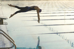 Female Dive Start. In early morning at outdoor pool stock images