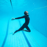 Female diver flying underwater Stock Images