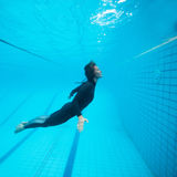 Female diver flying underwater Royalty Free Stock Images