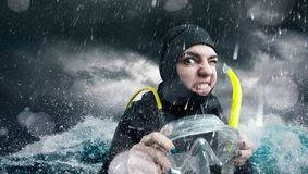 Female diver in the ocean, bad weather Royalty Free Stock Image