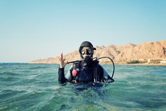Female diver. Shows a sign okay Stock Image