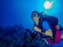 Female Diver Smiling at Camera stock images
